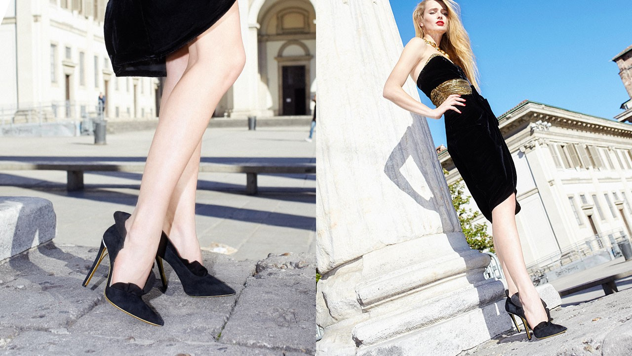 Half d'Orsay pump in black suede with ruffles.
